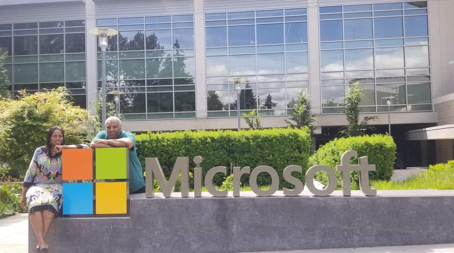 Michael Brown and his wife take the requisite 'first day' photo by the Microsoft logo
